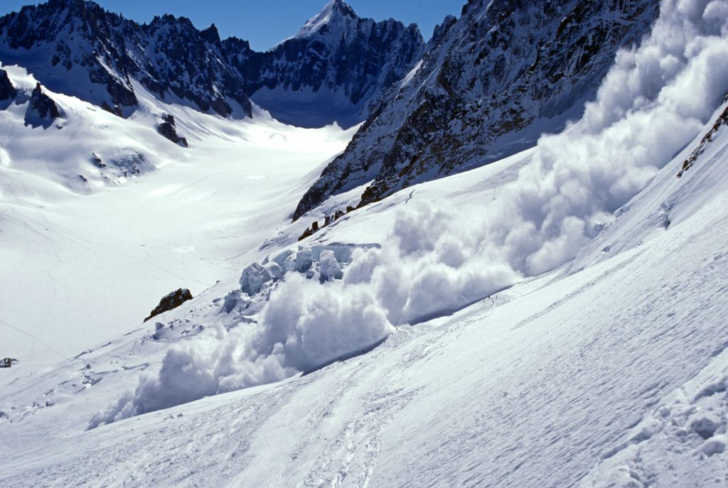 A30B2M Avalanche coming down over summer glacier ski tourers above Chamonix France